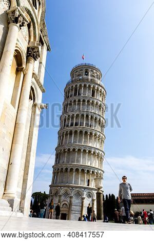Pisa, Italy - March 17, 2012: Tourists Walking Near The Tower Of Pisa Or Torre Di Pisa, Europe