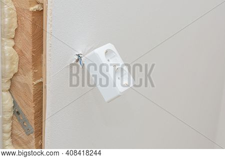 The Socket Is Installed On The Wall Of A Wooden House. The Socket Is Kept While On The Wires, It Wil