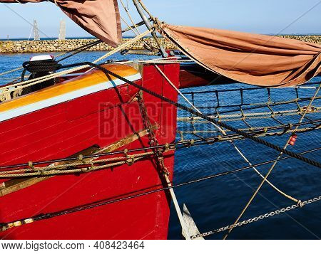 Bowsprit With The Danish Flag And Gathered Sail Of A Large Classical Traditional Vintage Tall Sailin