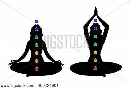 Female Black Silhouette With Seven Colored Chakras. A Woman Practices Yoga In The Lotus Position Wit