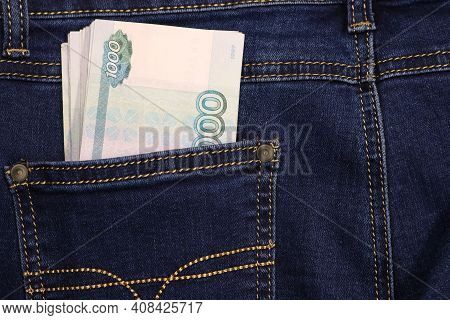 A Stack Of Russian Thousand-ruble Bills In A Pocket Of Blue Jeans. Money In Your Pocket, Cash. Trave