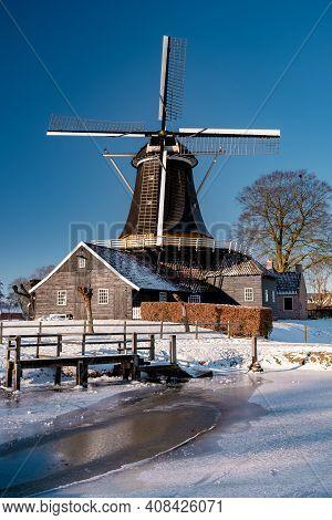 Pelmolen Ter Horst, Rijssen Covered In Snowy Landscape In Overijssel Netherlands, Historical Wind Mi