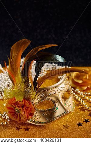 Festive, Colorful Mardi Gras Or Carnivale Mask With Feathers And Beads On Golden Background. Venetia