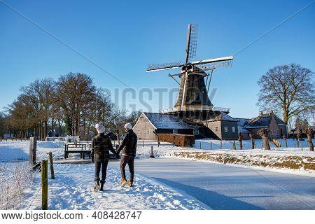 Pelmolen Ter Horst, Rijssen Covered In A Snowy Landscape Overijssel Netherlands, Historical Wind Mil