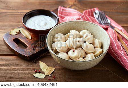 Dumplings Stuffed With Meat, Pelmeni, Ravioli, Dumplings. Traditional Homemade Russian Pelmeni Meat