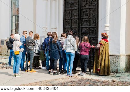Veliky Novgorod, Russia - April 29, 2018. Tour Guide Actress And Tourists At The Excursion At The Te