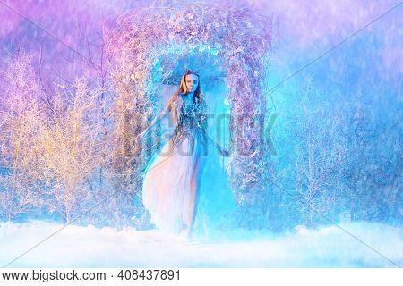 Full length portrait of lady from snowy tale in a magical winter forest.