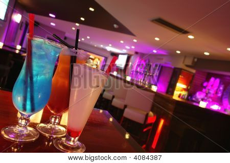 Three Cocktails In A Bar