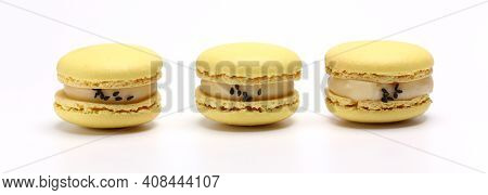Three Cake Of Macaron Or Macaroon Yellow Lemon Color. Delicious Macaroon Isolated On White Backgroun