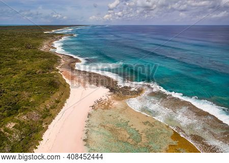 Aerial view of a desolate shoreline and coral formations along the Atlantic Ocean side of Cat Island, Bahamas