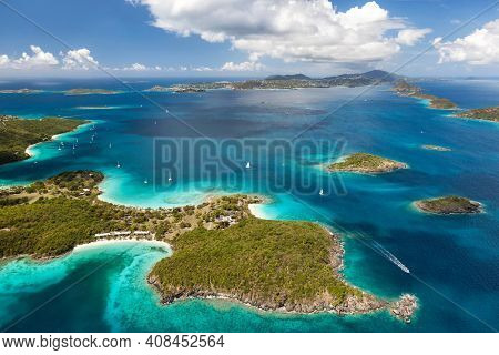 Aerial view of Caneel Bay on the island of St. John with St. Thomas in the distance in the United States Virgin Islands.