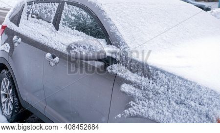 Is The Crossover Covered In Snow, The Car Was Covered With Wet Snow Close-up, The Passenger Car Was