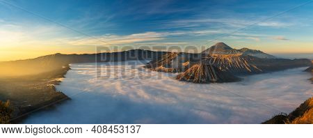 Bromo Volcano Mountain At Sunrise In East Java, Indonesia Surrounded By Morning Fog