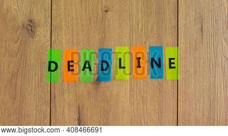 Deadline Symbol. Concept Word 'deadline' On Colored Papers On A Beautiful Wooden Background, Copy Sp