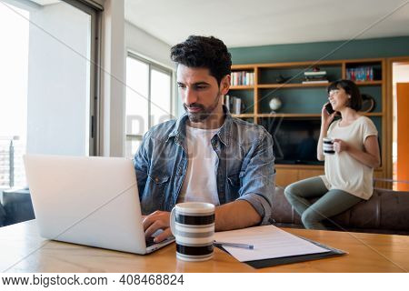 Portrait Of Young Man Working With A