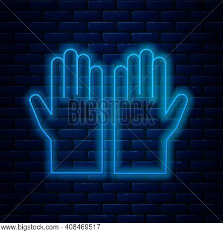 Glowing Neon Line Medical Rubber Gloves Icon Isolated On Brick Wall Background. Protective Rubber Gl