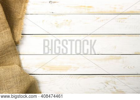 Rustic Culinary Template - Top View Of A White Empty Vintage Wooden Table With A Burlap Sack