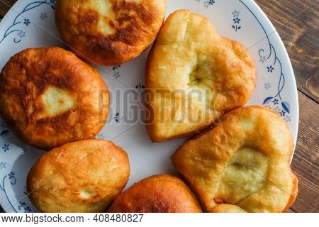 Home made donuts with heart shape on plate table top view