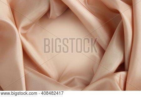 Beige Satin Material With Beautiful Pleats. Silk, Satin - Natural Fabric. Texture,