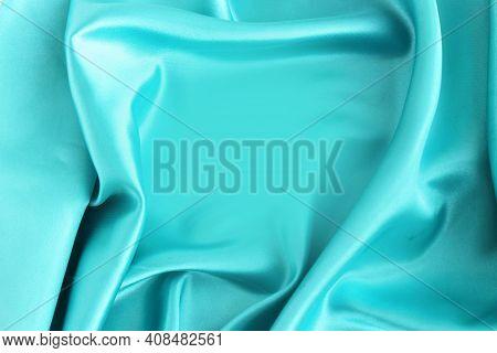 Light Blue Satin Material With Beautiful Pleats. Silk, Satin - Natural Fabric. Texture