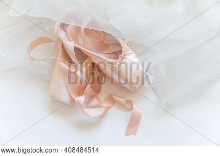 New Pastel Beige Ballet Shoes With Satin Ribbon And Tutut Skirt Isolated On White Background. Baller