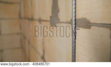 Metal Beacons For Plaster. Plastering Interior Walls. Installation Of Building Beacons.