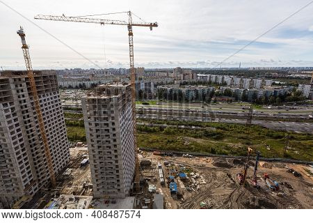 Large Construction Site Including Several Cranes Working On A Building Complex, Workers, Constructio