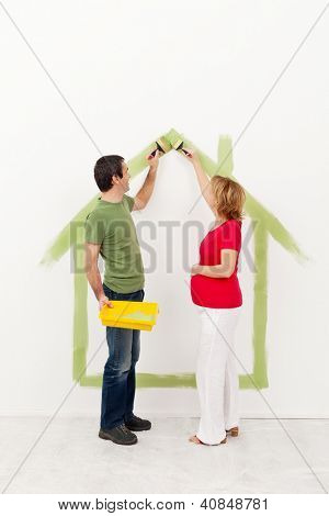Couple expecting a baby - painting their new home
