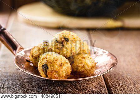 Cod Dumplings, Fish Meat Dumpling In A Slotted Spoon, Fried Salty