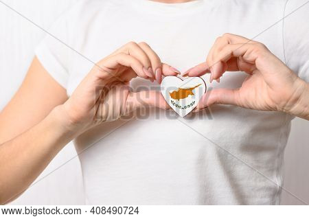 Love Cyprus. The Girl Holds A Heart In The Form Of The Flag Of The Republic Of Cyprus On Her Chest.