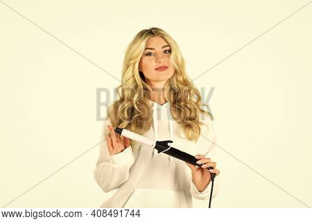 Girl Adorable Blonde Hold Curling Iron White Background. Form Exquisite Curls And Romantic Light Wav