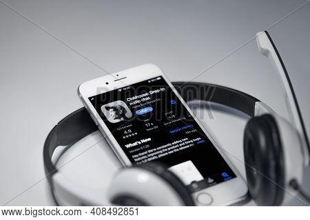 Minsk, Belarus - 16 February 2021 Clubhouse Audio App On Appstore With Headphones. New Popular Audio