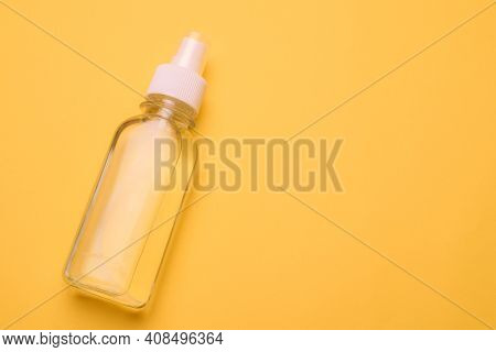 Antiseptic On A Yellow Background . Hand Treatment. Protection From The Virus. Antibacterial. A Jar