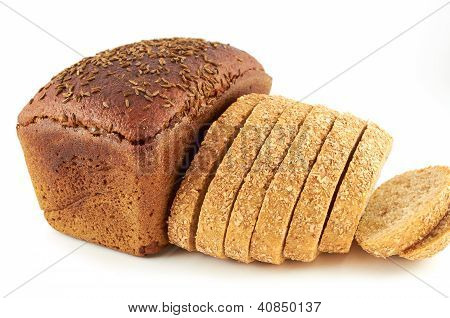 A loaf of rye bread topped with coriander seeds and sliced wheat ??bread with bran poster