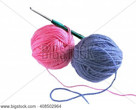 Ball Of Wool Yarn And Crochet Hook Isolated On White Background. Balls Of Red, Blue Wool Yarn And Kn