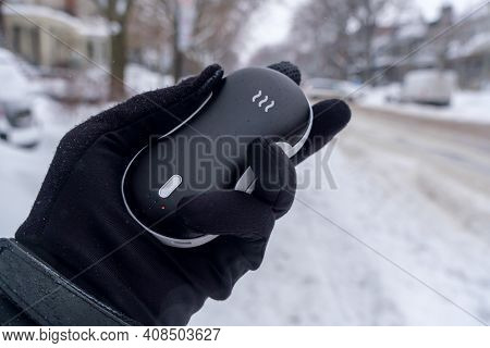 Closeup Of An Electric Pocket Hand Warm During Snow Fall