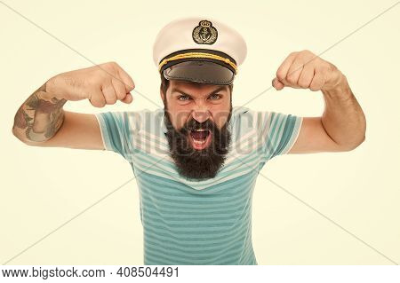 Brutal Man In Sailor Hat. Summer Marine Fashion Style. Male Power And Anger. Travel And People Conce