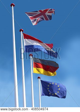 Flags Of France, Germany And The European Union On Flagpoles. Flag Of The United Kingdom Is Leaving
