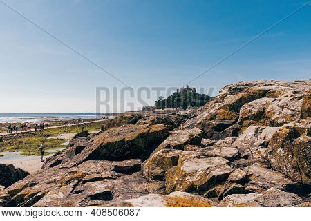25 July 2018: Marazion, Cornwall, Uk-view Of St. Michael's Mount From The Chapel Rock. The Rock Is T