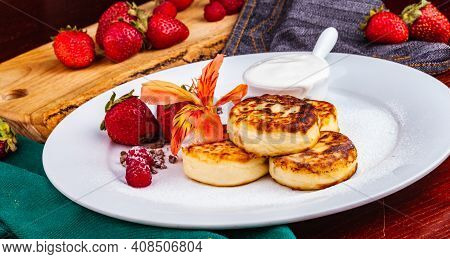 Breakfast. Cottage Cheese Pancakes, Syrniki, Curd Fritters With Fresh Berries Raspberry And Strawber