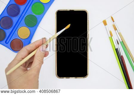 Female Hand With Brush On Empty Blank Mockup Smart Phone Screen Painting Online Courses. Creative Ed