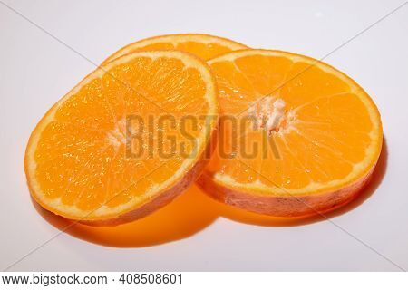Clementines Fruit Slices Isolated On White Background Closeup.