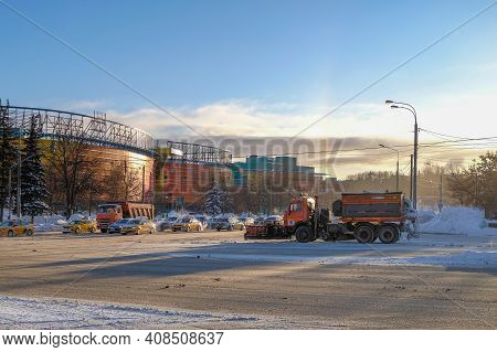 Moscow. Russia. February 15, 2021. A Truck Clearing Snow From The Roadway Stands At A Crossroads In