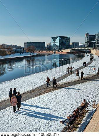 People, Berliners Walk Along Spree River Enjoying Snow. Berlin Main Railway Station Hauptbahnhof, Hb