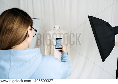 Ar Vr Technology In Fashion Industry. Female Designer Shotting Clothes On Mannequin By Cell Phone Fo