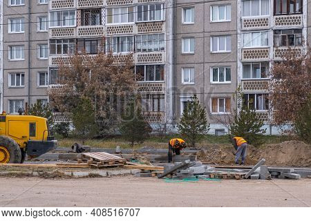 Russia, Angarsk - October 19, 2020 Construction, Repair Of A Road In A Residential Area Of The City.