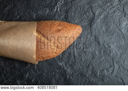 Top View Of British Baton Loaf Bread On Black Background