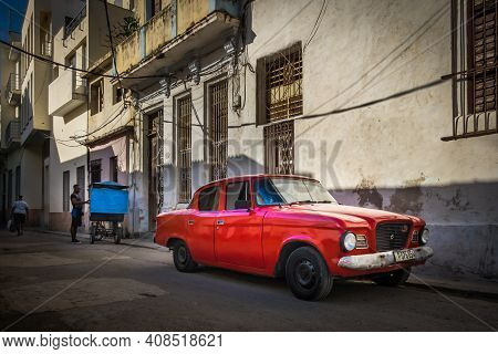 Havana, Cuba, July 2019, View Of A Retro Red Car Parked In A Street In The Old Part Of The Capital