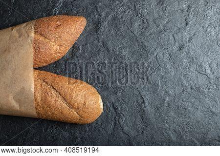 Freshly Baked British Baton Loaf Bread On Black Backround