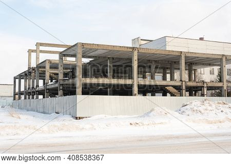 Abandoned Unfinished Concrete Building In Winter. Abandoned Building
